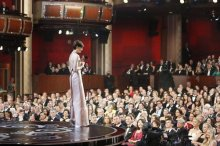Anne Hathaway holds her Oscar for supporting actress in