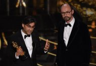 Asif Kapadia and James Gay-Rees accept the award for Best Documentary Feature, Amy, on stage at the 88th Oscars