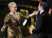 Colin Firth presents the best-actress Oscar to Meryl Streep, who won for her role in 'The Iron Lady.'