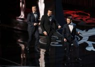 Oscars host Seth MacFarlane, gets help from Actor Joseph Gordon-Levitt and actor Daniel Radcliffe perform onstage during one of the many opening numbers.