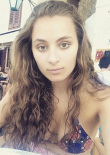 Rowan Atkinson's daughter Lily posted this selfie from a recent holiday abroad in which she shows off her bikini top