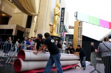 Workers move red carpet as preparations are made for the 87th Academy Awards in Los Angeles, Wednesday, Feb. 18, 2015. The Academy Awards will be held at the Dolby Theatre on Sunday, Feb. 22. (AP)